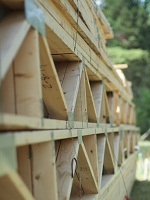 Building trusses and pallets stacked on top of each other