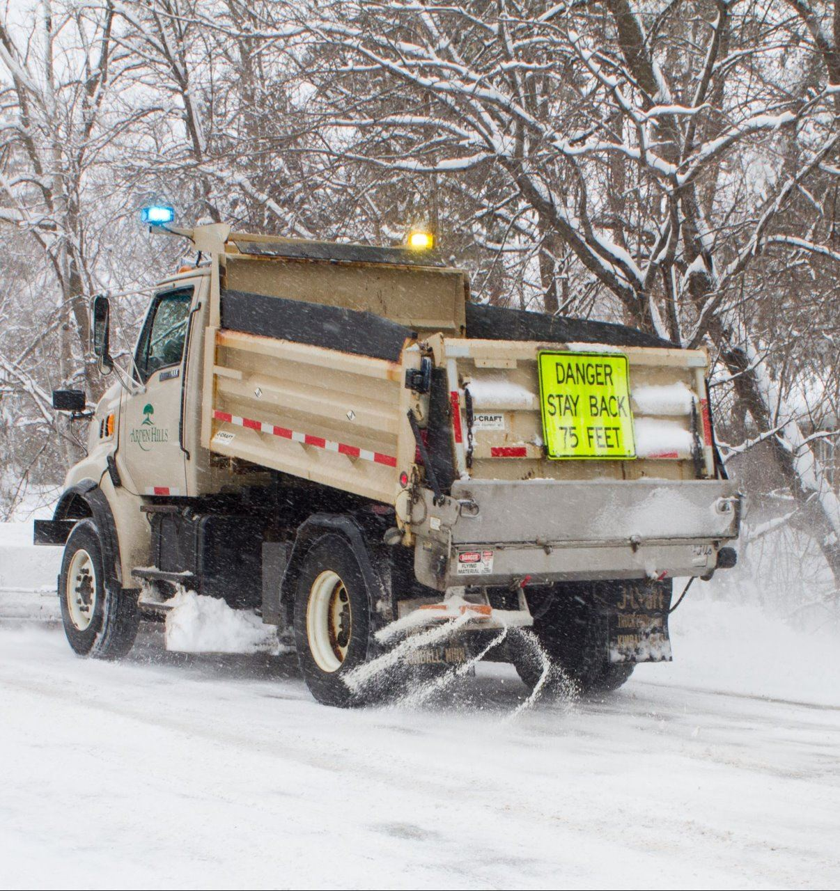 city snowplow on street