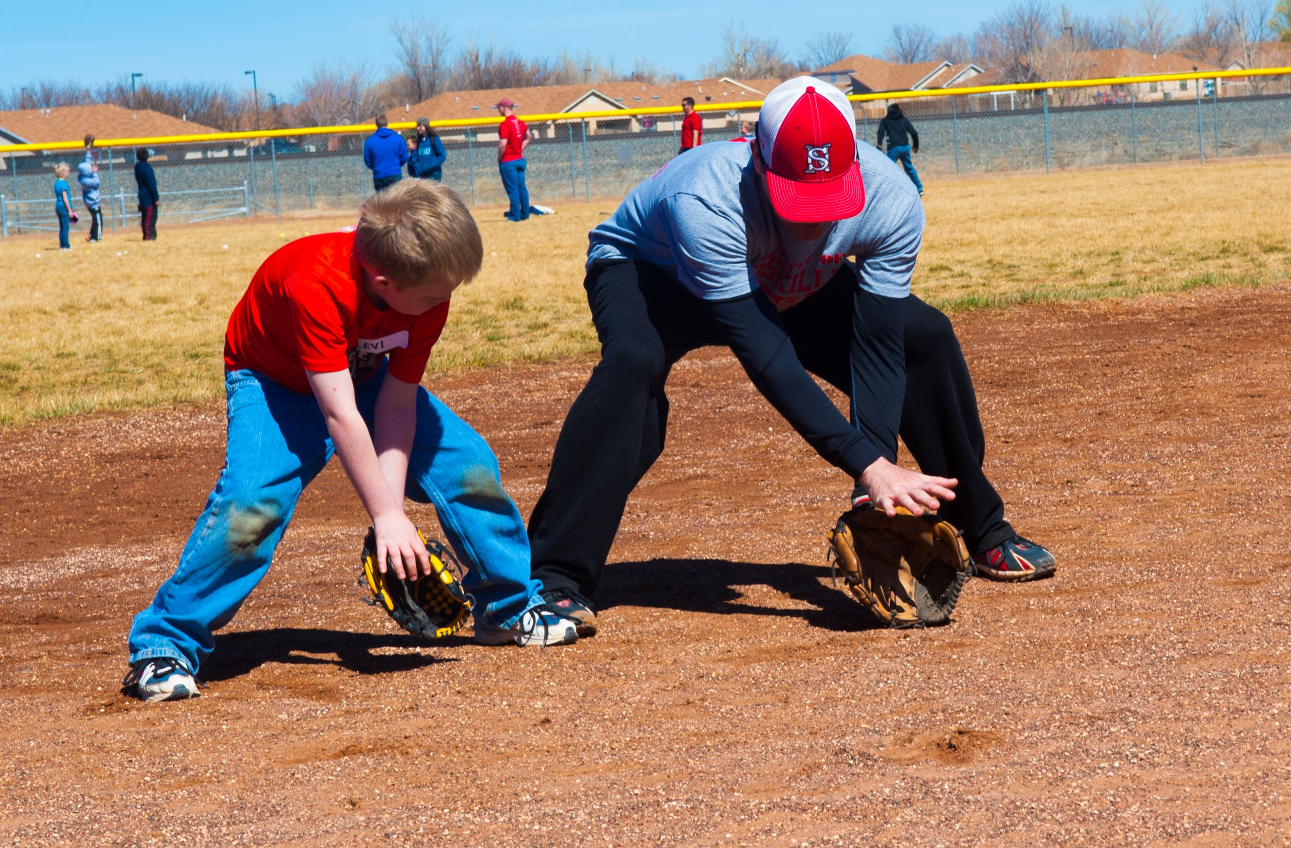 Young Boy Learning how to Field Groundballs