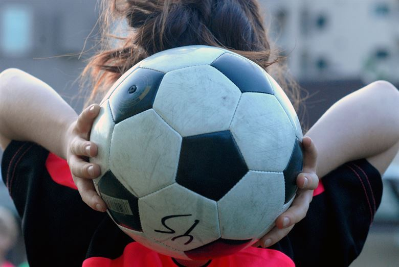 Young child holding soccer ball