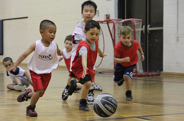 Young Kids Playing Basketball
