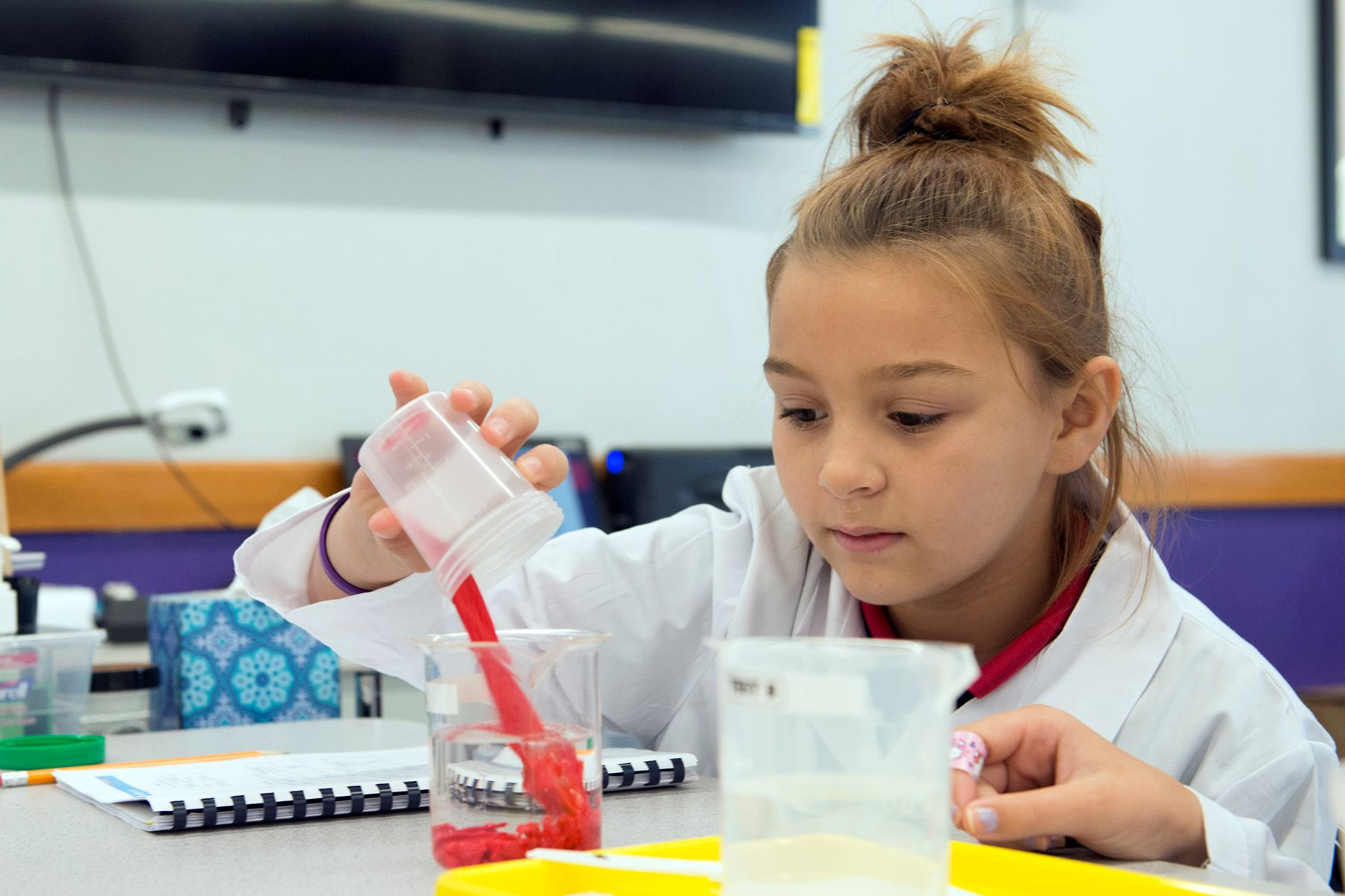 Young girl performing a science experiment