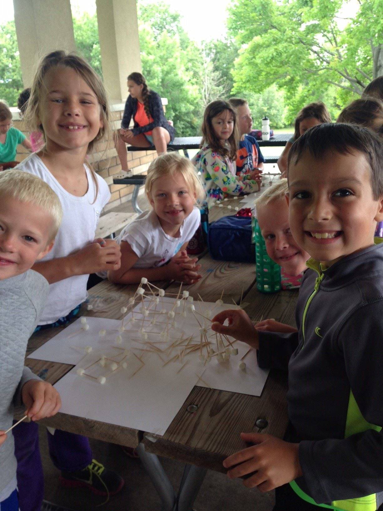 Kids doing toothpick crafts