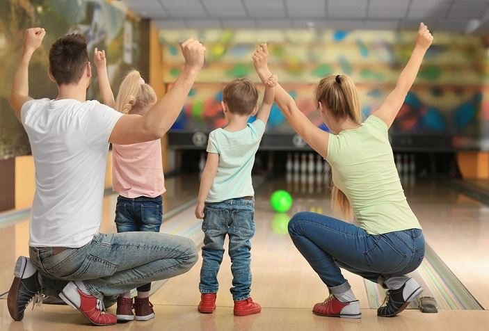 Family bowling together