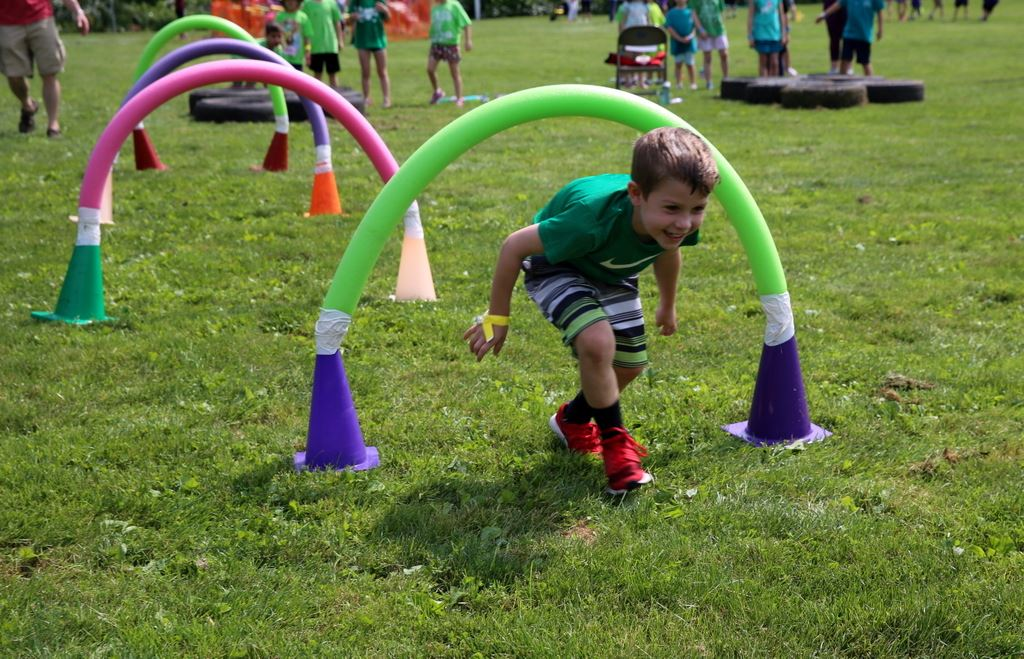 Young boy going through obstacle course