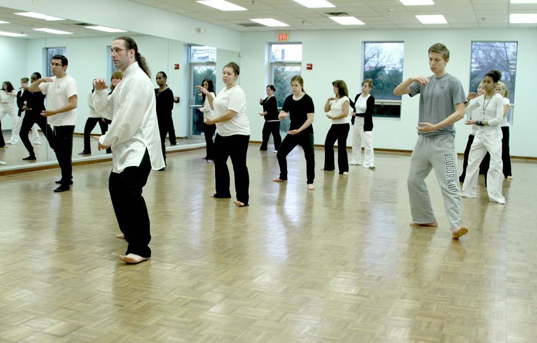 Students Practicing Tai Chi in an Indoor Studio